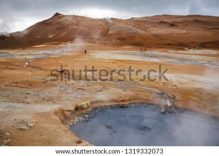 Hot boiling mud pool at Námafjall Hverir geothermal area in Mývatn region, Northeastern Iceland, Scandinavia