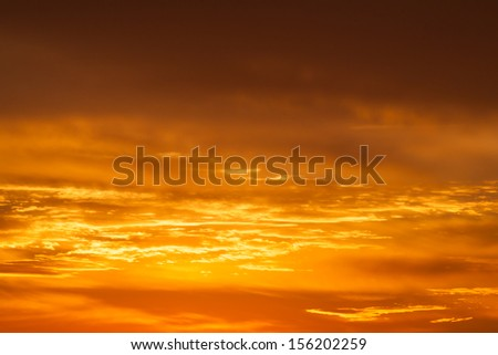 Hot bright vibrant orange and yellow colors sunset sky