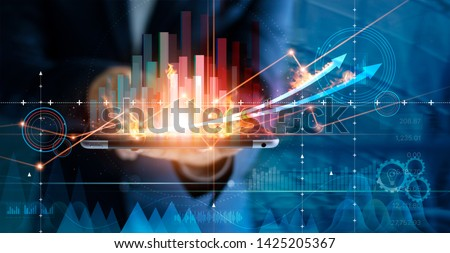 Hot business growth. Businessman using tablet analyzing sales data and economic growth graph chart. Business strategy, financial and banking. Digital marketing.  Stockfoto ©