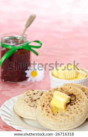 Hot buttered crumpets with jam