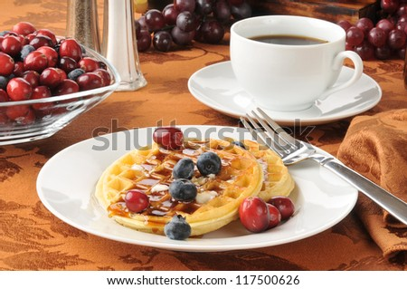 Hot buttered waffles with fresh berries and coffee