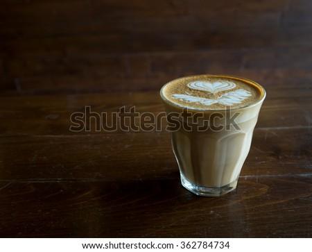 Hot Cafe Latte art on dark light wood background #362784734