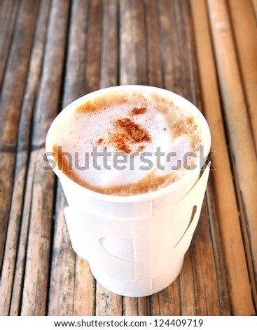 hot cappuccino in paper cup
