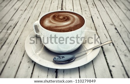 hot cappuccino in white ceramic cup on wooden white table