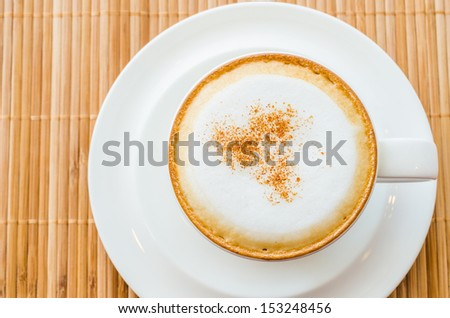 Hot cappuccino in white cup