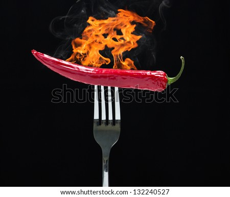 hot chilly on fork with fire