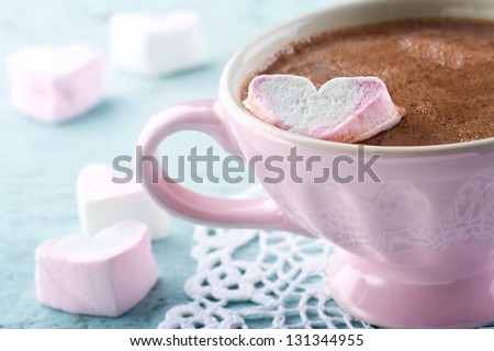 Hot chocolate and a heart shaped marshmallow in a vintage pink cup Zdjęcia stock ©