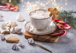 Hot chocolate cacao drinks with marshmallows in Christmas mugs on grey background. Traditional hot beverage, festive cocktail at X-mas or New Year