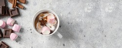 Hot chocolate cup with whipped cream decorated with star anise and marshmallow. Large image for banner.