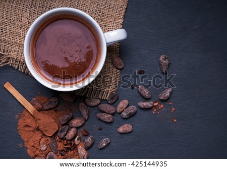 Hot chocolate in a cup, dark styled photo, top view