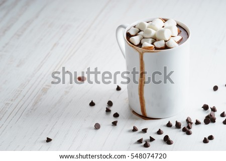 hot chocolate in white cup with marshmallows and chocolate chip #548074720