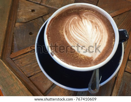 Hot chocolate latte cup  in wood table #767410609