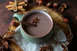 hot chocolate with cinnamon and star anise in a large ceramic cup
