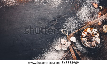 Hot chocolate with marshmallou, nuts, spices, chocolate konfeti, cinnamon. On the black Wooden desk. Stok fotoğraf ©