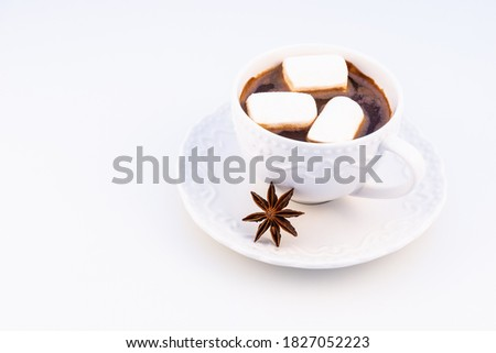 Hot chocolate with marshmallow and anasone on a white background, top view. Stok fotoğraf ©