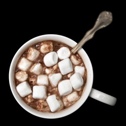 Hot chocolate with marshmallows isolated on black background, photographed from directly above.