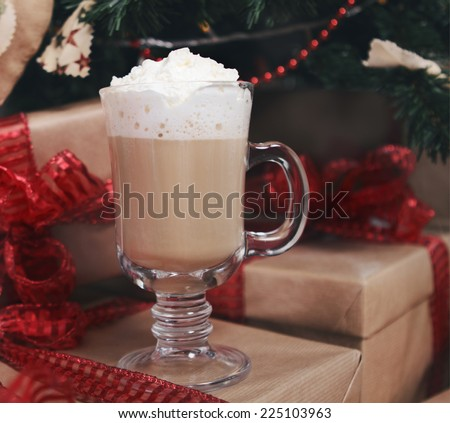 Hot chocolate with presents under the Christmas tree