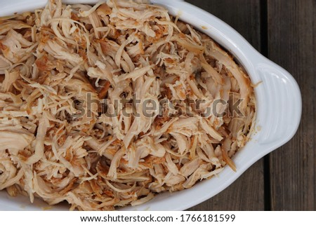 Hot Classic Barbecue Pulled Chicken On The White Ceramic Plate On The Dark Wooden Table. Сток-фото ©