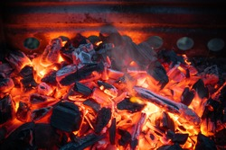 Hot coal with sparks. A barbecue in the open air.