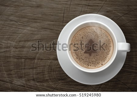 Shutterstock Hot coco foam made the shape of tree in a white cup on top wooden table background , Concept for Christmas's day.