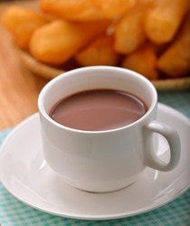 Hot cocoa with deep fried dough stick  for breskfast