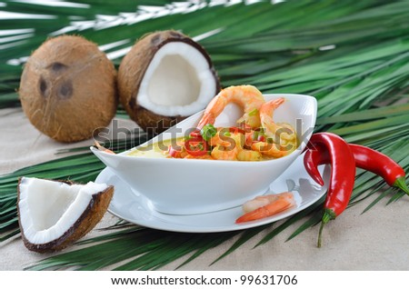 Hot coconut prawn soup with chili and curry - stock photo