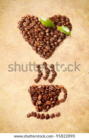 Hot Coffe Cup and a heart shape figured with coffee beans