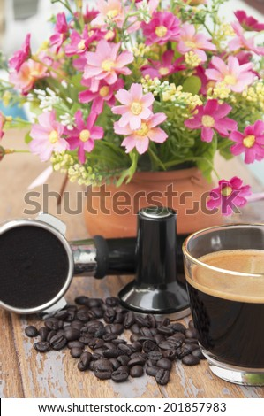Hot coffee and coffee making equipment with flower clay pot.