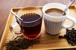 Hot coffee and tea on a wooden table