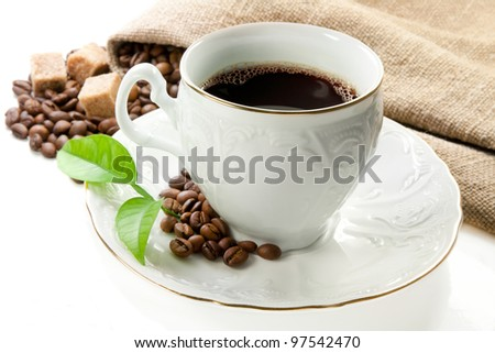 Hot coffee, coffee grains and brown sugar.