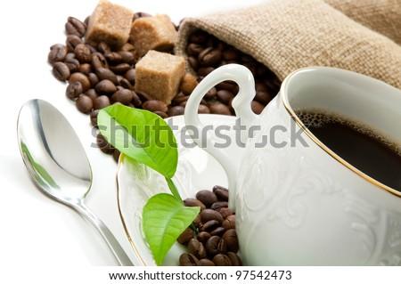 Hot coffee, coffee grains and brown sugar.