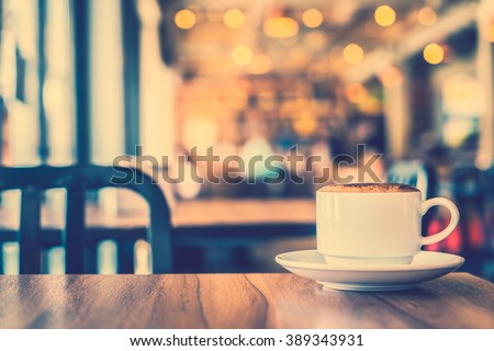 Hot coffee cup in coffee shop cafe - Vintage filter Processing