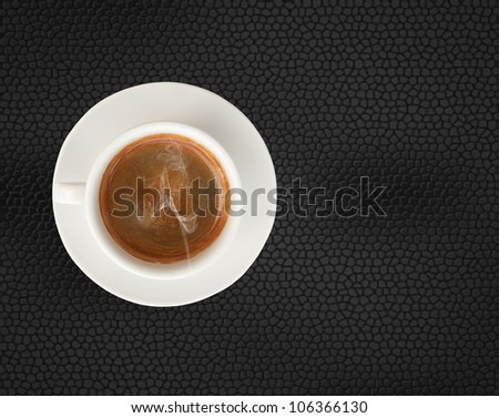 hot coffee cup isolated on black  leather pad background