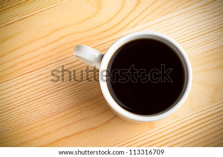 Hot Coffee Cup on a Wooden Table - stock photo