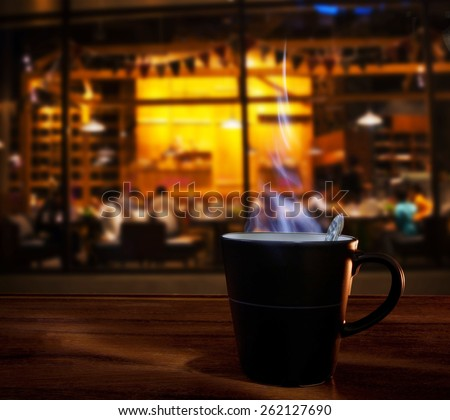 hot coffee cup on wood table in coffee cafe shop use for food and drink in modern restaurant
