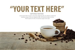 Hot Coffee cup with coffee beans roating on the wooden table and the white background with copyspace for your text.