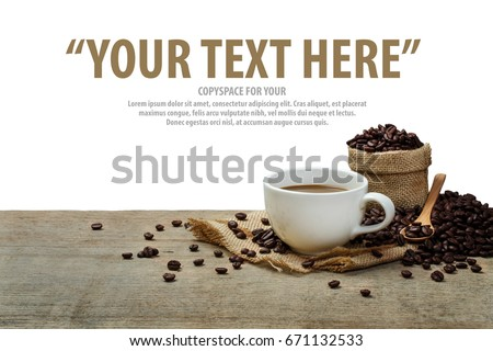 Hot Coffee cup with coffee beans roating on the wooden table and the white background with copyspace for your text. #671132533