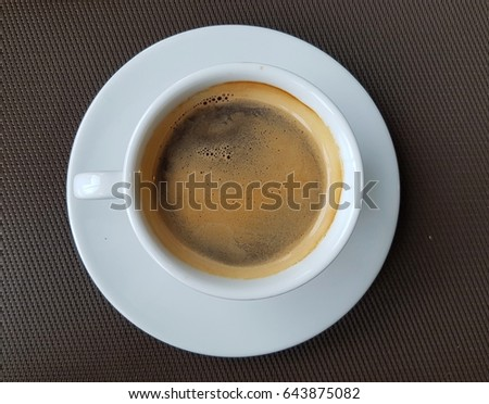 Hot coffee in white cup. #643875082