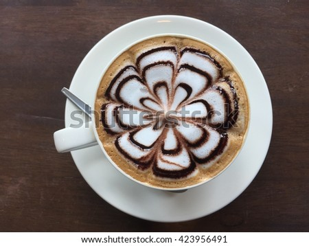 Hot coffee in white cup on the  table. #423956491