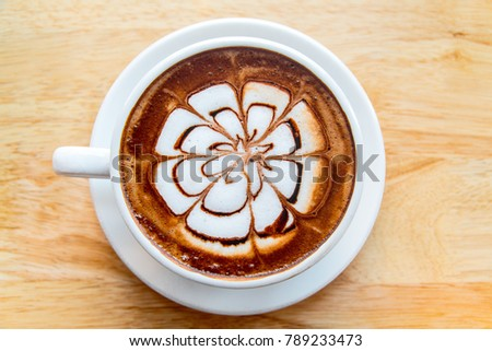hot coffee mocha latte on wooden table background #789233473