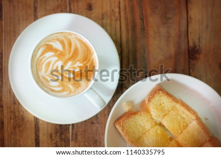 Hot coffee on wooden table, The best materials for processing fresh coffee. Coffee porcelain cup on table with breakfast, soft focus, free space for text. Industrial food and drink background concept.