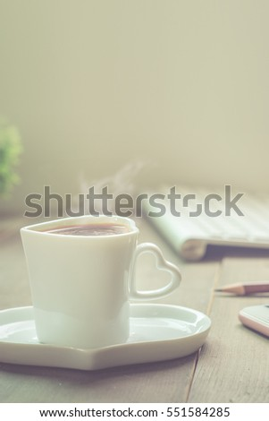Hot coffee, smart phone and computer, working from home #551584285