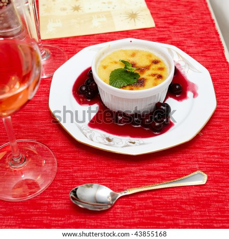 hot creme brulee dessert with spearmint on a dish