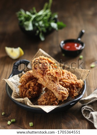 Hot Crispy fried chicken, is a dish consisting of chicken pieces which have been coated in a seasoned batter and pan-fried, deep fried, or pressure fried.
