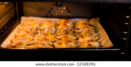 hot croissant with peach in oven
