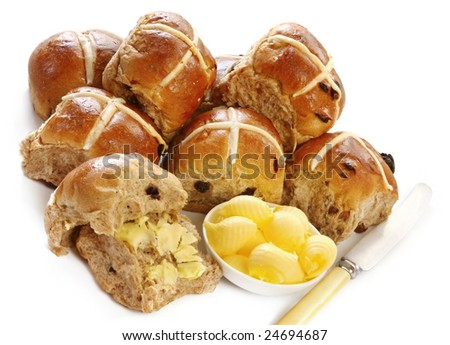 Hot cross buns, with a dish of butter curls and vintage knife.  A delicious Easter treat.