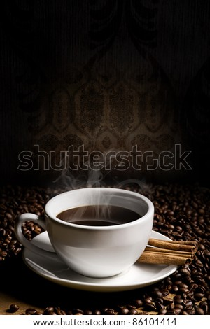 hot cup of coffee, bean and aromatic cinnamon