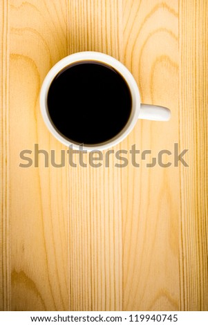 Hot Cup of Coffee on a Wooden Table
