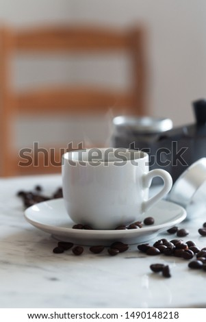 Hot cup of espresso coffee and coffee maker on a table, vertical orientation, white background, vertical orientation #1490148218