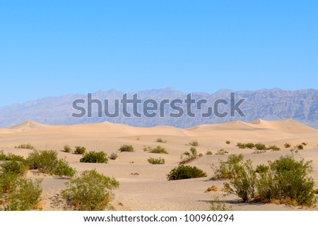 Hot Death Valley Desert with Mountains in background, US
